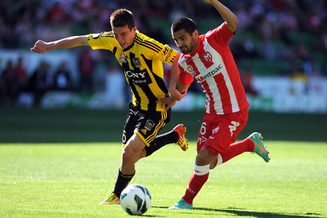 Wellington's Louis Fenton battles for the ball with the Heart's Aziz Behich (Photosport)