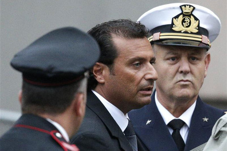 The captain of the Costa Concordia Schettino is surrounded by an Italian Carabinieri policeman and a Navy officer as he leaves at the end of the preliminary hearings in Grosseto (Reuters)