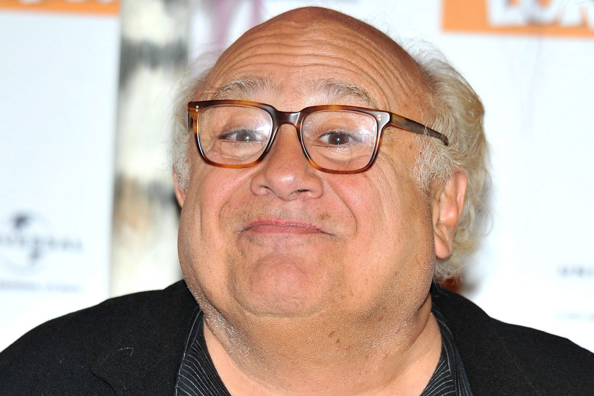 Danny DeVito embracing...
