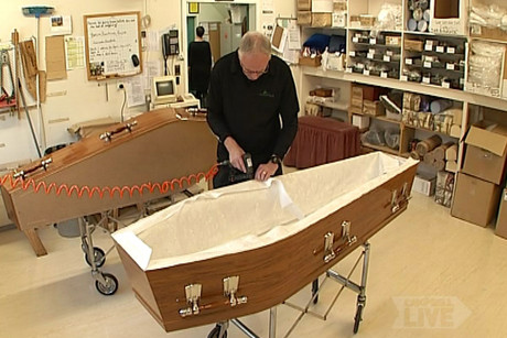A coffin being made
