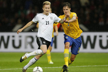 Marco Reus of Germany is tackled by Sweden's Mikael Lustig (Reuters)