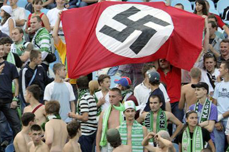 Racism in football is not new, here Supporters of Karpaty Lviv hold a German Nazi flag with a swastika (Reuters file)