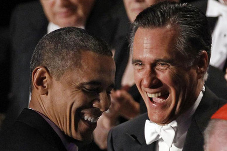 Barack Obama (left) and Mitt Romney share a laugh at the dinner (Reuters)