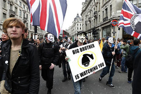 Demonstrators hold placards during a protest march in central London (Reuters)