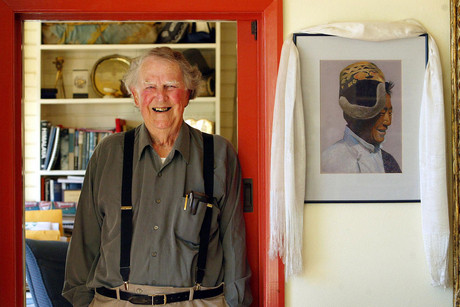 83-year-old Sir Edmund Hillary, at home in Auckland next to a portrait of Sherpa Tenzing, who was at his side as he reached the summit in 1953 (AAP)