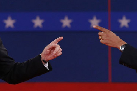 Romney (L) and Obama (R) gesture at each other during the second debate (Reuters file)