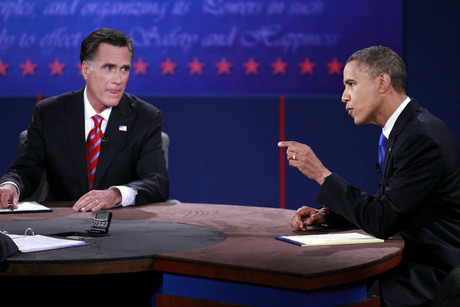 US Republican presidential nominee Mitt Romney (L) listens as US President Barack Obama answers a question during the final US presidential debate in Boca Raton, Florida (Reuters/Joe Skipper)