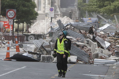 A New Zealand Urban Search and Rescue worker walks through the central business district during a search of earthquake damaged buildings in Christchurch (AAP)