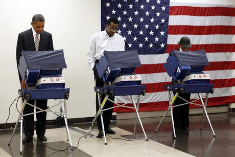 US President Barack Obama casts his vote early at the Martin Luther King Community Center in Chicago (Reuters)