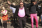 "Chinese artist Ai Weiwei (centre) dances in a parody of Psy's ""Gangnam Style"" (Supplied)"