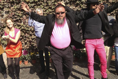 Chinese artist Ai Weiwei (centre) dances in a parody of Psy's &quot;Gangnam Style&quot; (Supplied)