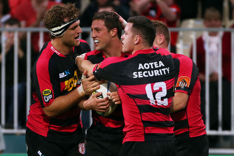 Tom Taylro celebrates his second try with his team mates (Photosport file)