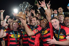 Canterbury captain George Whitelock holds the ITM Cup as his team mates celebrate around him (Photosport)