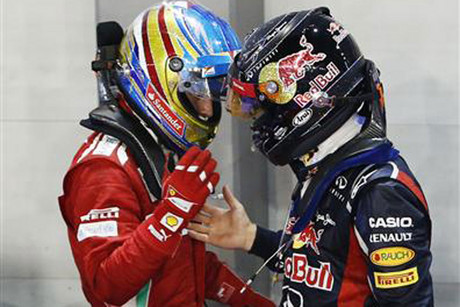 Ferrari Formula One driver Alonso (L) of Spain and Red Bull Formula One driver Vettel of Germany (Reuters file)
