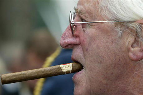 File photograph shows disgraced British entertainer Jimmy Savile arriving at the unveiling of a new monument, commemorating the fighter pilots who fought in the Battle of Britain, in London (Reuters)