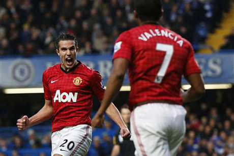 Robin van Persie celebrates his goal (Reuters)