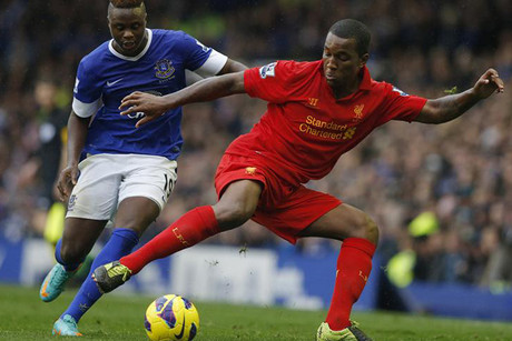 Everton's Magaye Gueye, left, challenges Liverpool's Andre Wisdom (Reuters)