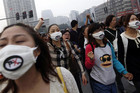 Protesters march against plans to expand a petrochemical plant in Ningbo, Zhejiang province (Reuters)