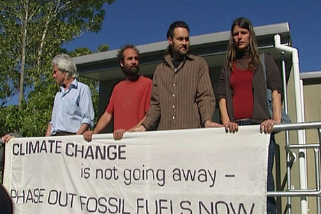 Just a few protestors gathered outside the Environment Court to mark the first day of the hearing, which should decide the fate of the Denniston Plateau