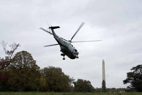 President Barack Obama takes off from the White House under clouds from the approaching Hurricane Sandy (Reuters)