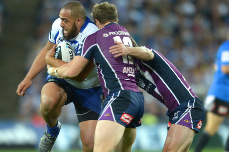 Canterbury Bulldogs' Sam Kasiano pushes through Melbourne Storm's defence in the NRL Grand Final (NZN)
