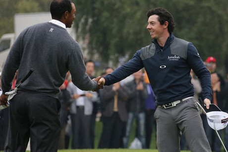 Rory McIlroy, right, beat Tiger Woods, both receiving massive pay days (Reuters)