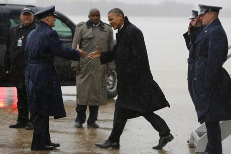 President Barack Obama arrives in rainy Washington as Hurricane Sandy makes landfall (Reuters)