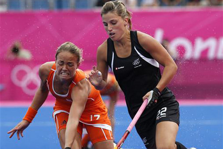 Netherlands' Maartje Paumen, left, challenges New Zealand 's Gemma Flynn at the London 2012 Olympics (Reuters file)