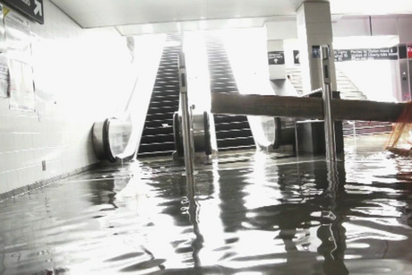Water is seen covering the floor of the South Ferry–Whitehall Street subway station in this still image, taken from a video released by New York's Metropolitan Transport Authority