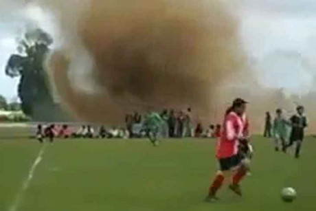 Even a mini tornado couldn't deter these footballers in South America