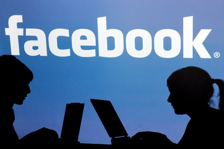 The median age of people joining Facebook is 22  (file)