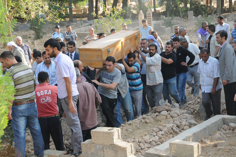 Relatives carry the coffin of a victim who was killed by a Syrian mortar bomb (Reuters)