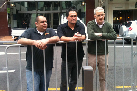Willis St and Bond St retailers Arsel Aslam of Wholly Bagels, Peter Kelly of Butler Chocolates and Dale Rangihaeata say business is down around 35 percent because of the pedestrian barriers (Photo: Emma Jolliff)