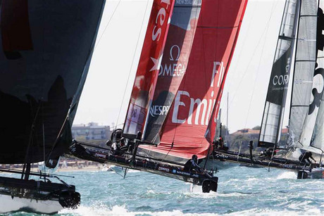 Emirates Team New Zealand (middle) flies across the water (Reuters file)