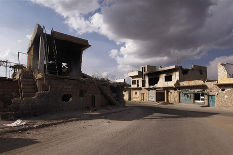 A view of houses destroyed in clashes between forces loyal to Syria's president Bashar al-Assad and rebels in Kafranbel (Reuters)