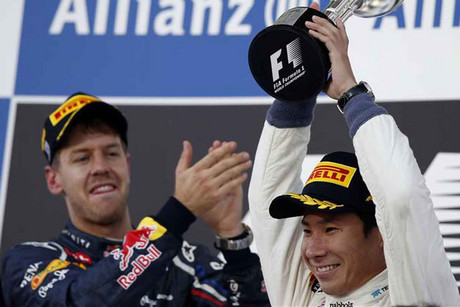 Kamui Kobayashi is congratulated by Sebastian vettel on his third place finish (Reuters)