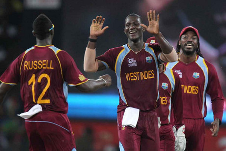 West Indies captain Darren Sammy (2-L) celebrates with team mates after taking a wicket (AAP)