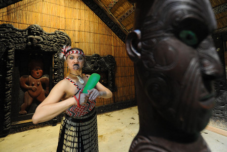 Maori dancer Toni Ann Stewart poses in front of the Maori House Rauru at the Museum of Ethnology in Hamburg (AAP)
