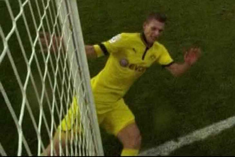 Borussia Dortmund's Lukaz Piszczek gets the post between the legs