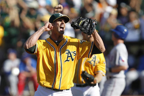 Oakland Athletics pitcher Grant Balfour celebrates after winning the American League West Division title in Oakland (Reuters)