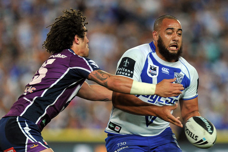 The Bulldogs' Frank Pritchard (right) is tackled by Kevin Proctor of the Melbourne Storm during the NRL Grand Final (NZN)