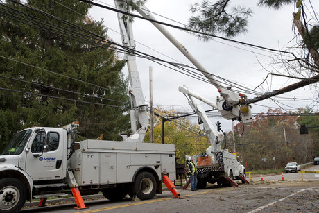 NStar Electric utility crew members work on restoring primary power lines in Needham, Massachusetts (AAP)