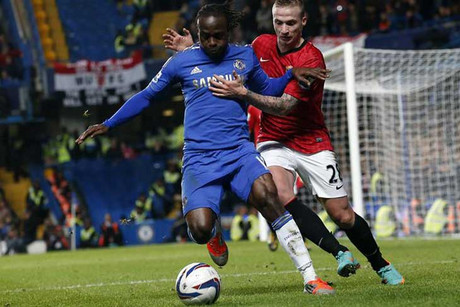Manchester United's Alexander Buttner, right, challenges Chelsea's Victor Moses (Reuters)