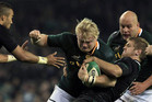 South Africa's Adriaan Strauss is tackled (Reuters)