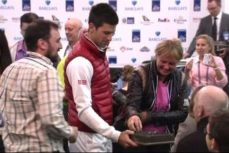 Novak Djokovic hands out chocolates to the press