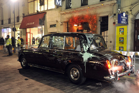 Prince Charles and his wife Camilla's car after it was attacked by protesters in London in November 2010 (AAP file)