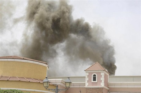 Smoke billows from the Villagio Mall during the fire  (Reuters)