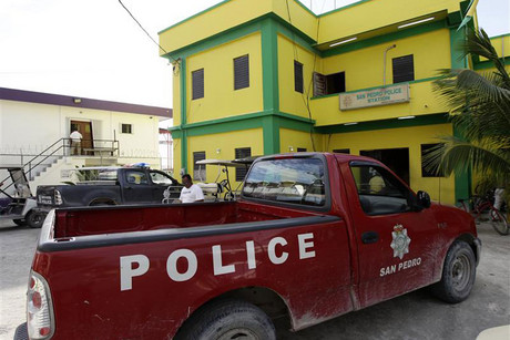 A police vehicle is parked outside at a police station in San Pedro (Reuters)