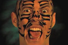 Danny Morrison appears in the ad wearing face paint