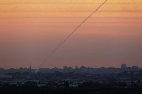 A smoke trail is seen as a rocket is launched from the northern Gaza Strip (Reuters)